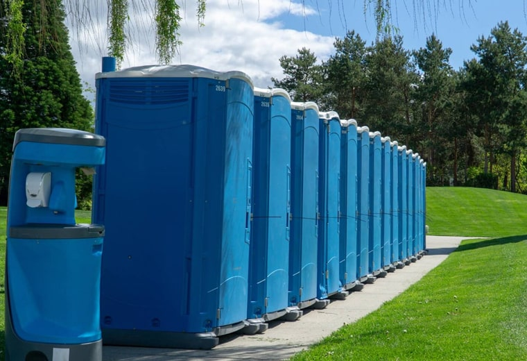 standard porta potties at a park